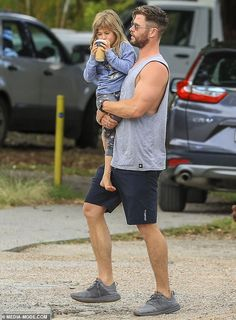 Proud father: Chris later carried India Rose in his arms, who attempted to drink her fathe. Chris Hemsworth Family, Liam Hemsworth, Snowwhite And The Huntsman, Daddy Daughter, Husband, India Rose, Hot Dads, Elsa, People Magazine