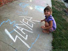 Makena, the world's cutest metalhead, drawing the SLAYER logo in sidewalk chalk.