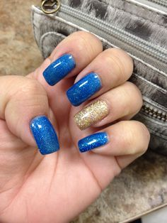 Nail art - blue & glittery gold