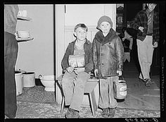 Young boys waiting in kitchen of city mission for soup which is given out nightly. Dubuque, Iowa. April 1940. Photographer: John Vachon. For millions, soup kitchens offered the only food they would eat.