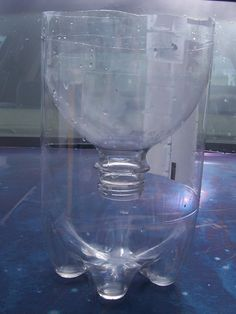 Fruit fly or wasp/bee trap made from 2 liter pop bottle.  Add apple cider vinegar, fruit juice or a piece of fruit to the bottom of bottle to attract the pests.  They can crawl in but cannot crawl back out!