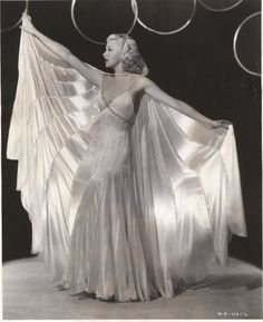 "Ginger Rogers wearing the stunning dress and cape combo for the number ""Never Gonna Dance."" The movie is ""Swing Time"", 1936. Gown designed by Bernard Newman."