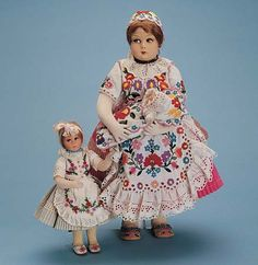 Authentic peasant costumes were made for the Hungarian mother, girl, and baby dolls shown at the 1939 New York World's Fair. The mother has a pressed cloth head.