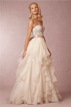 Ivory Ruffled Wedding Gown - 24 Elegantly Tailored Wedding Dresses for Pear Shaped Body - EverAfterGuide