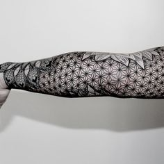 another beautiful example of geometric print tattoos.