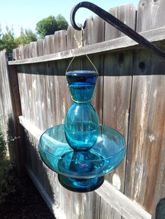 Hey, I found this really awesome Etsy listing at http://www.etsy.com/listing/163333851/teal-blue-glass-hanging-bird-feeder
