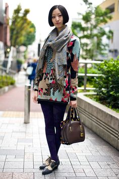 Morika, JNBY, Tokyo  Scarf:  Blue and Gold Paisley Scarf  Top:  Geometric JNBY Sweater  Tights:  Floral Pattern Tights  Bag:  Orange Print Bag, Brown Bag  Shoes:  Black/Nude Wingtips  Photo By:  Phil Oh