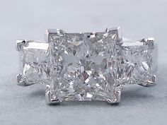 This is our gorgeous 5.88 ctw Princess Cut Diamond Engagement Ring that has a divine 3.81 carats Princess Cut G Color/SI2 Clarity (Clarity Enhanced) Center diamond. It is accented by two equally gorgeous 1 carat Princess Cut accent diamonds in an elegant setting. It is made of 14K White Gold and listed for $34,990. Unique Wedding Bands, Diamond Wedding Bands, Diamond Rings, Diamond Engagement Rings, Wedding Rings, I Love Jewelry, Jewelry Box, Wedding Honeymoons, Honeymoon Ideas