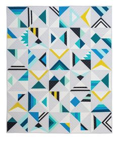 Hi guys! The official Modern Triangle Quilts blog tour will happen at the end of March, but the quilt parade begins today! I'll be starting with the quilts being shown at QuiltCon in Savannah…