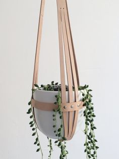 Modern leather plant hanger, ceiling planter, minimalistic hanging planter made from nude vegetable tanned leather. This leather is very thick and can