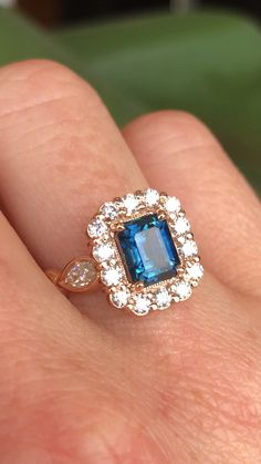 This stunning montana sapphire with a diamond halo and rose gold setting is simply to die for. This ring was custom designed by Abby Sparks Jewelry. Rose Gold Infinity Ring, Gold Knot Ring, Diamond Wedding Rings, Sapphire Jewelry, Blue Sapphire Rings, Engagement Ring Cuts, Steel Jewelry, Ring Verlobung, Or Rose