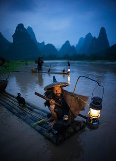 This was the wildest thing I've ever seen. I got in close to this fisherman on the Li River, and he had his trusty bird-friend right behind him. No matter which way the fisherman turned his head, the bird looked the exact same way. It reminded me of the daemons from His Dark Materials. I have about 6 frames I shot where they are all looking in the same direction as they rotate their heads. - Li River, China - Photo from #treyratcliff Trey Ratcliff at http://www.StuckInCustoms.com