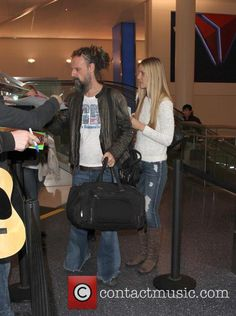 Rob Zombie - Rob Zombie And His Wife Sheri Moon Zombie Arrive At Los Angeles International Airport (LAX) Horror Movie Characters, Horror Movies, Sherri Moon Zombie, Rob Zombie Film, The Devil's Rejects, White Zombie, Kim And Kanye, Gypsy Life, International Airport