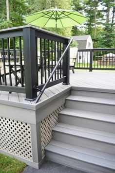 the intricacies of the custom rail on this deck in Burlington, MA.Notice the intricacies of the custom rail on this deck in Burlington, MA. Deck Stain Colors, Deck Colors, Deck Colour Ideas, Cool Deck, Diy Deck, Best Deck Stain, Deck Makeover, Deck Railings, Decks And Porches