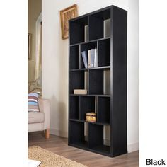@Overstock.com - Nordic Cubbyhole Bookcase/ Display Shelf - Sleek and stylish, this contemporary black bookcase would make an eye-catching statement in any room. Featuring a unique cubbyhole design, this black bookcase can be constructed vertically or horizontally to suit your own personal style.  http://www.overstock.com/Home-Garden/Nordic-Cubbyhole-Bookcase-Display-Shelf/4854527/product.html?CID=214117 $242.99