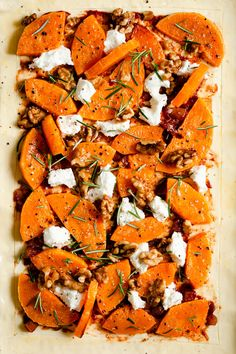 Super easy recipe for butternut squash & goats cheese tart with rosemary and walnuts from Anna Banana Co. This savoury tart served with side salad will make a perfect midweek dinner! #vegetarian #easyrecipe