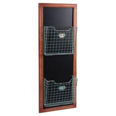 Wood wall organizer with a metal basket and chalkboard background.  Product: Wall organizerConstruction Material: