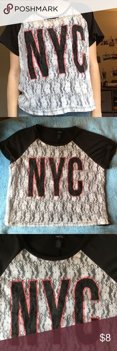 """NYC tee Block letters spell out """"NYC"""" in black and pink. lace in the front. Only been worn a few times. Rue 21 Tops Tees - Short Sleeve"""