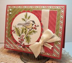 handmade Christmas/winter card by Vicki Burdick of It's a Stamp Thing ... vanilla, red and olive ... luv the bird on holly image ... luscious satin bow wraps the top panel like a package ... wonderful card! ... Stampin' Up!