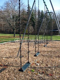 A line of swings on a sunny autumn afternoon.