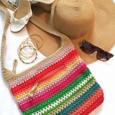 """The Sak Multicolored Woven Crossbody The Sak woven crossbody bag with multicolored stripes. One outside zippered pocket, 3 inside pockets. Width: 12.5"""", Height: 11"""", Depth: 2.5"""", Strap: 36"""". 1/2"""" ink stain on bottom of one inner pocket (see last photo), otherwise excellent condition. The Sak Bags Crossbody Bags"""