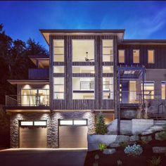 Hey! @laurie_march here. As night falls, I'm so inspired by this beautiful, glowing home by @jordan_iverson ... Rustic wood meets stacked stone in such a lovely way! Another fabulous #KBIS find... #design #remodeling #building #curbappeal #modern #kbistakeover #hgtvdesign