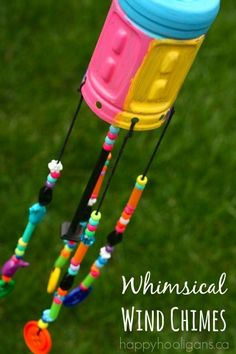 These Recycled Bottle Wind Chimes will add a burst of colour to any outdoor play space or patio! I'm really excited to share our latest DIY wind chimes with you!  We LOVE making homemade wind chimes here in my home daycare.  We've made so many different sets of homemade chimes for the hooligans to give to their parents, and also to hang in the backyard here at my daycare. These particular chimes were a collaborative project.  We all worked on them and then we hung them in our ba...