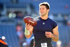 """Who doesn't love Tim Tebow?"" ESPN poll voted America's Favorite Athlete, featured on Jan. 11, 2012. Photo by Garrett Ellwood. Getty Images."