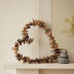 Drill a hole in driftwood chunks, use sturdy wire  and make a pretty heart wreath.