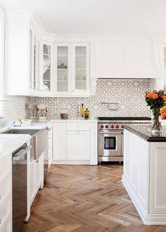 i love the backsplash. designer: kishani perera.  photo by joe schmelzer.  via: miss moss | kitchens i like.
