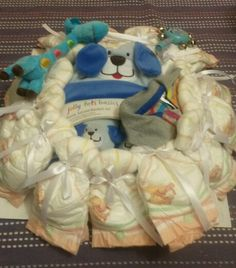Nappy wreath baby shower gift. With receiving blanket, t.shirt, soft toy and rattle