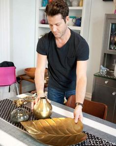 Use warm metallics to add glitz to a Fall tablescape like Nate Berkus. See all his tablesetting tips on ELLE DECOR.   - ELLEDecor.com