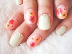 Sweet flowers and stars nail design.