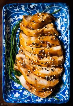 Teriyaki Chicken! Skinless chicken breasts poached in homemade teriyaki sauce, served with toasted sesame seeds. Quick and easy 30-min recipe!