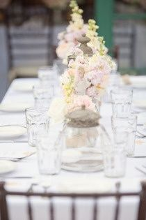 one long rectangle table for all guests with large runner-like centerpiece