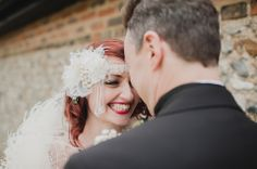 Smiling red haired bride wearing a 1920s style headpiece.  http://www.michellewaspe.com/