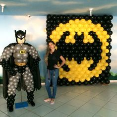 Batman takes the lead in this scene. ---  You can build balloon backdrops, balloon walls, balloon graphics, and other balloon decorations similar to the batman symbol in this picture using #RouseMATRIX™ Builder #BalloonGrids that you will find in Ballooniverse Mall ( https://bvsmall.com/collections/modular-grids-1/products/mp-bldr-3x6-h-50a-11l-2pk )
