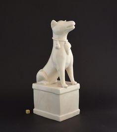A Rare Large Kangxi Blanc de Chine Porcelain Incense-Stick Holder Modelled as a Seated Dog. Kangxi Period c.1680-1710, Dehua Kilns, Fujian Province.