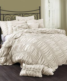 This sophisticated set brings a sense of classic style to bedroom décor. With rich embroidery and faux silk fabric, this comforter is sure to create a cozy atmosphere ready for rest and relaxation.