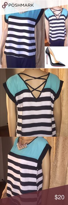 Color Block Striped Shirt w/ Criss Cross Back Silky Block shirt with caged back detail. Super cute with short sleeves and is super soft and light to the touch. Black, white and a seafoam/turquoise color on top. Brand new with tags. 🎇 Bundle and save! Reasonable offers accepted. 🎇 Tops Blouses