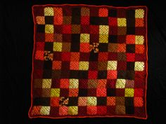 This is kind of a dark picture, but I love the autumn colors in this granny square blanket mom made.  It seems completely random at first, but there is a pattern in there.