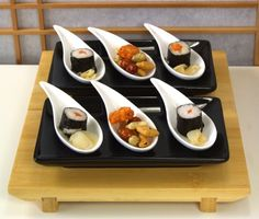 Modern Canape' spoons.     http://www.giftsoftheorient.co.uk/table--kitchen-ware-18-c.asp.
