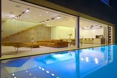 Along the side of the home, parallel to the pool, is an expansive glass wall that maximizes the feeling of openness in the first floor living space. The pool is heated by a repeated energy air-conditioning system, which conserves energy expenditure.