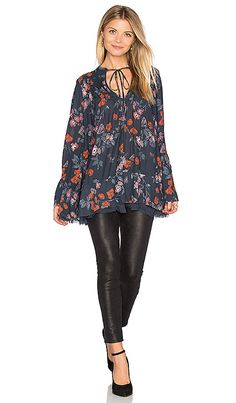 Shop for Free People Pebble Crepe So Fine Smoked Tunic Top in Navy at REVOLVE. Free 2-3 day shipping and returns, 30 day price match guarantee.