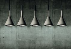 Concrete lamps. Would look great over kitchen island or in the hallway. Or if you got balls....over the dining table!