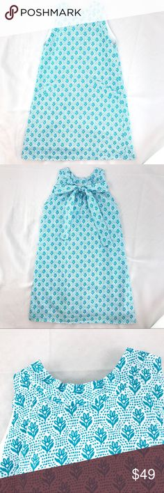 Oscar de la Renta Girl's 8Y Floral Shift Dress Oscar de la Renta girl's blue and white floral sleeveless shift dress * Size 8 Yr * 65% polyester, 35% cotton * 2 small pockets in front * Gently used with no flaws found Oscar de la Renta Dresses Casual