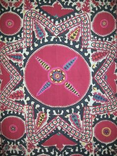 A beautiful Uzbek Tashkent region silk suzani / susani embroidery. It dates to late 19th century / early 1900 and has a gorgeous powerful design with a large archaic star design at ...