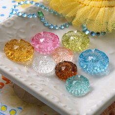 Lovely colours- I have just sewn some glass buttons like these onto my new blouse!