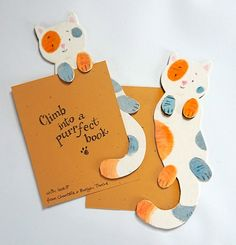 How about these cute kitty bookmarks for the BookMark project? It was fun to make the little paws hold onto the top of the page and have the tail curl around it 😃 You can find these as lots 119 and 120 on the BookMark Projects site (works like E-bay), so head on over to www.jumblebee.co.uk/bookmarkpr… to bid an raise funds for Katiyo School in Zimbabwe.  PS The other bookmarks we made are lots 121, 122 and 123. Yes, we got a bit carried away! You know what avid bookworms we are 😉