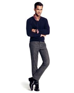 Shop this look on Lookastic:  http://lookastic.com/men/looks/longsleeve-shirt-and-v-neck-sweater-and-dress-pants-and-socks-and-oxford-shoes/823  — Pink Long Sleeve Shirt  — Navy V-neck Sweater  — Grey Wool Dress Pants  — Black Socks  — Black Leather Oxford Shoes